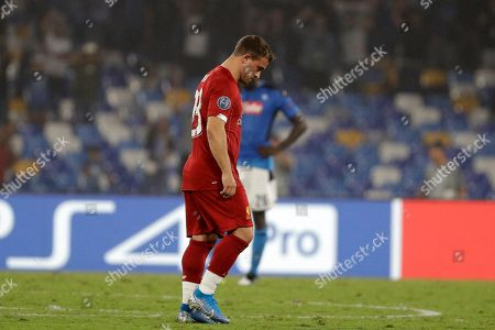 Liverpool's Xherdan Shaqiri reacts after the second goal of Napoli during the Champions League Group E soccer match between Napoli and Liverpool, at the San Paolo stadium in Naples, Italy