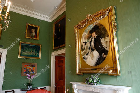 This, photo shows a portrait of former first lady Edith Roosevelt, right, wife of President Theodore Roosevelt, in the Green Room of the White House in Washington. The portrait was placed in the Green Room as part of the improvement projects first lady Melania Trump has overseen to keep the well-trod public rooms at 1600 Pennsylvania Avenue looking their museum-quality best