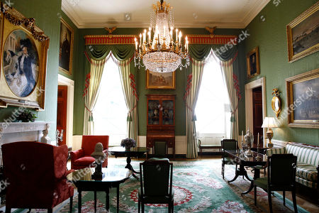 This, photo shows repurposed draperies in the Green Room of the White House in Washington, which are among the improvement projects that first lady Melania Trump has overseen to keep the well-trod public rooms at 1600 Pennsylvania Avenue looking their museum-quality best