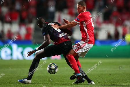 Stock Image of SL Benfica player Adel Taarabt (R) in action against RB Leipzig's Konate during their UEFA Champions League Group G soccer match at Luz Stadium, Lisbon, Portugal, 17 September  2019.