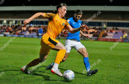 Danny McNamara of Newport County and Connor Kirby of Macclesfield Town