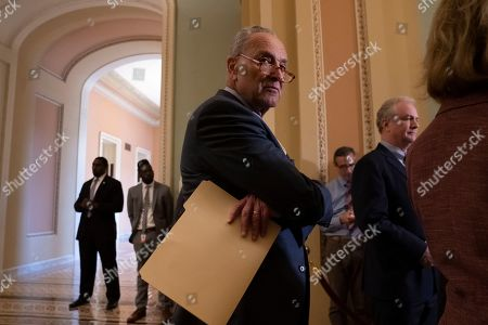 Chuck Schumer, Chris Van Hollen. Senate Minority Leader Chuck Schumer, D-N.Y., joined at right by Sen. Chris Van Hollen, D-Md., pauses during a news conference at the Capitol in Washington
