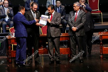 The manager of National Institute of Statistics Nestor Guerra (L) delivers the national population census book to the Guatemalan President Jimmy Morales (2-R), the Vice Minister of Ecomony Acisclo Valladares (2-L); and the Vice President Jafeth Cabrera (R) during its launch event in Guatemala City, Guatemala, 17 September 2019. Guatemala has 14.9 million inhabitants and a reduction of the population under 15, which causes a 'moderate aging process' and the beginning of the 'demographic bonus'. 51.5% of the country's population corresponds to women (7.678.190), while 48.5% corresponds to men (7.223.096). These are some of the results of the census released Tuesday by the Government of Guatemala.