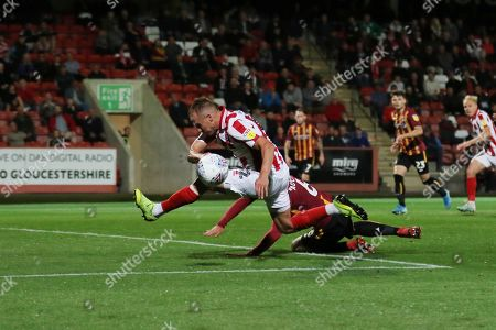 Luke Varney is tackled by Anthony O'Connor  during the EFL Sky Bet League 2 match between Cheltenham Town and Bradford City at Jonny Rocks Stadium, Cheltenham