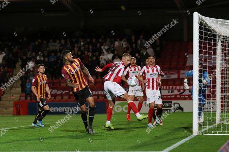 Luke Varney heads a chance  during the EFL Sky Bet League 2 match between Cheltenham Town and Bradford City at Jonny Rocks Stadium, Cheltenham