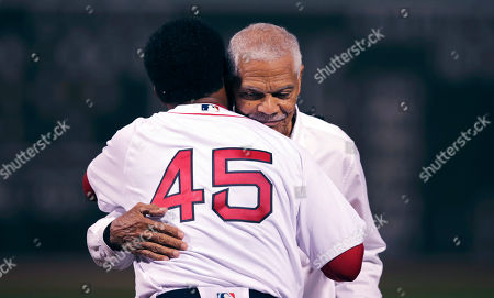 Felipe Alou, Pedro Martinez. Former Major League Baseball player and manager Felipe Alou, right, embraces his former player, Hall of Fame pitcher Pedro Martinez (45) after throwing out the ceremonial first pitch prior to a baseball game at Fenway Park in Boston