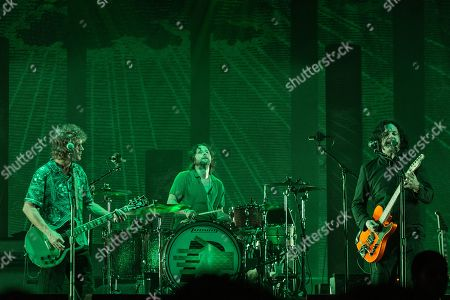 Stock Picture of The Raconteurs - Brendan Benson, Patrick Keeler and Jack White