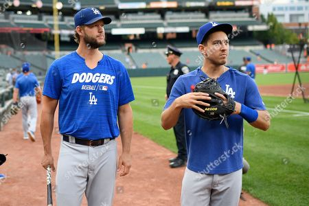 Stock Picture of Los Angeles Dodgers' Clayton Kershaw, left, talks with Austin Barnes, right, before a baseball game against the Baltimore Orioles, in Baltimore