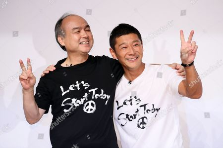 SoftBank CEO and Chairman Masayoshi Son (L) and, founder of Zozo and Japanese billionaire Yusaku Maezawa pose for a photo session after Maezawa agreed to sell his stake in online fashion shopping site Zozo to Yahoo Japan. SofBank Group has more than 48 percent stake in Yahoo Japan. Zozo founder Maezawa stepped down as the Chief Executive
