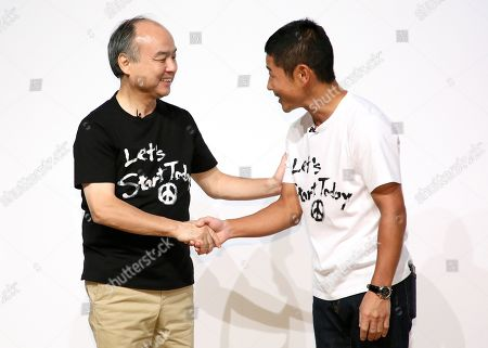 Stock Image of SoftBank CEO and Chairman Masayoshi Son (L) and, founder of Zozo and Japanese billionaire Yusaku Maezawa shake hands each other after Maezawa agreed to sell his stake in online fashion shopping site Zozo to Yahoo Japan. SofBank Group has more than 48 per cent stake in Yahoo Japan. Zozo founder Maezawa stepped down as the Chief Executive