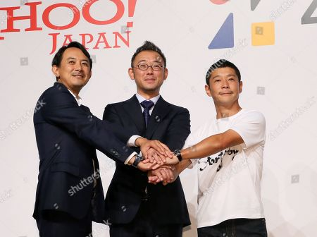 Stock Photo of Founder of Zozo and Japanese billionaire Yusaku Maezawa (R) pose for a photo session with his successor Kotaro Sawada (C) and Yahoo Japan CEO Kentaro Kawabe after Maezawa agreed to sell his stake in onlune fashion shopping site Zozo to Yahoo Japan. Zozo founder Maezawa stepped down as the Chief Executive