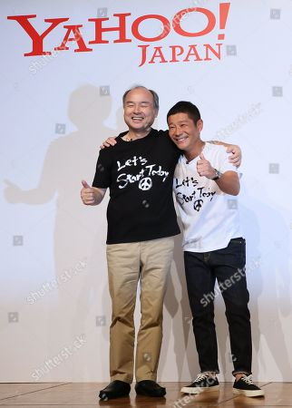 SoftBank CEO and Chairman Masayoshi Son (L) and, founder of Zozo and Japanese billionaire  Yusaku Maezawa pose for a photo session after Maezawa agreed to sell his stake in online fashion shopping site Zozo to Yahoo Japan. SofBank Group has more than 48 per cent stake in Yahoo Japan. Zozo founder Maezawa stepped down as the Chief Executive