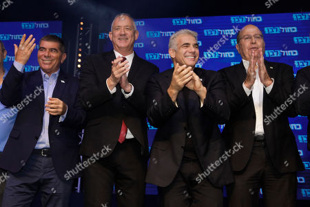 Blue and White party leaders, from the left, Gabi Ashkenazi, Benny Gantz, Yair Lapid and Gabi Ashkenazi greet their supporters at party headquarters after the first results of the elections in Tel Aviv, Israel