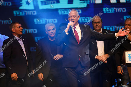 Blue and White party leaders, from the left, Gabi Ashkenazi, Yair Lapid, Benny Gantz and Gabi Ashkenazi greet their supporters at party headquarters after the first results of the elections in Tel Aviv, Israel