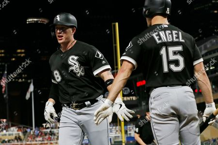 Zack Collins, Adam Engel. Chicago White Sox's Zack Collins, left, is congratulated by Adam Engel after Collins hit a solo home run off Minnesota Twins pitcher Trevor May in the sixth inning of a baseball game, in Minneapolis. Engel followed with a solo home run