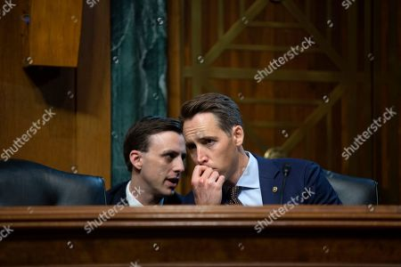 Stock Picture of United States Senator Josh Hawley (Republican of Missouri) speaks to an aide