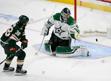 Minnesota Wild winger Ryan Hartman (38) shoots the puck past Dallas Stars goalie Landon Bow to score during the second period of a preseason NHL hockey game, in St. Paul, Minn