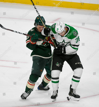 Minnesota Wild center Luke Johnson, left, and Dallas Stars center Joel L'Esperance battle for the puck during the second period of a preseason NHL hockey game, in St. Paul, Minn