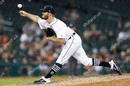 Detroit Tigers' David McKay pitches against a Baltimore Orioles batter during the 11th inning of a baseball game, in Detroit