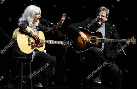 Emmylou Harris, Vince Gill. Country music singers Emmylou Harris, left, and Vince Gill perform together at the All for the Hall Benefit at The Novo, in Los Angeles. The event was a fundraiser for the Country Music Hall of Fame and Museum in Nashville, Tenn