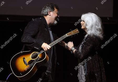 Vince Gill, Emmylou Harris. Country music performers Vince Gill, left, and Emmylou Harris greet each other onstage at the All for the Hall Benefit at The Novo, in Los Angeles. The event was a fundraiser for the Country Music Hall of Fame and Museum in Nashville, Tenn