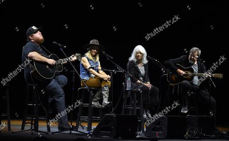 Luke Combs, Emmylou Harris, Sheryl Crow, Vince Gill. Country singer Luke Combs, far left, performs alongside, left to right, Sheryl Crow, Emmylou Harris and Vince Gill at the All for the Hall Benefit at The Novo, in Los Angeles. The event was a fundraiser for the Country Music Hall of Fame and Museum in Nashville, Tenn