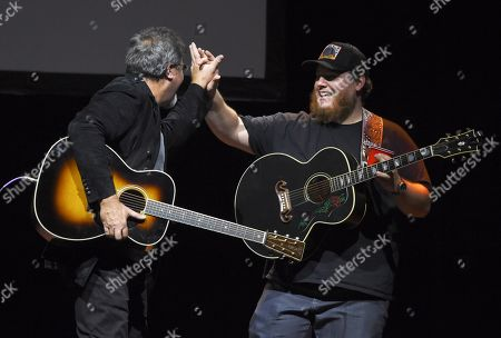 Vince Gill, Luke Combs. Country singers Vince Gill, left, and Luke Combs greet each other onstage at the All for the Hall Benefit at The Novo, in Los Angeles. The event was a fundraiser for the Country Music Hall of Fame and Museum in Nashville, Tenn