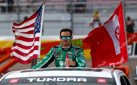 Kyle Larson looks on before a NASCAR Cup Series auto race at the Las Vegas Motor Speedway on