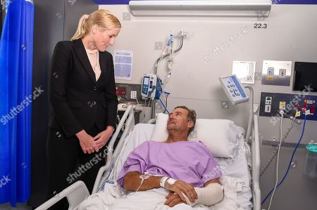 Surgeon Nicola Ward (L) speaks to bushwalker Neil Parker (R) at Princess Alexandra Hospital in Brisbane, Australia, 18 September 2019. Neil Parker, 54, fractured his leg and wrist in the six-metre fall on 15 September while walking by himself in Cabbage Tree Creek on Mount Nebo, northwest of Brisbane.