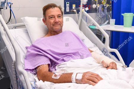 Bushwalker Neil Parker poses for a photograph at Princess Alexandra Hospital in Brisbane, Australia, 18 September 2019. Neil Parker, 54, fractured his leg and wrist in the six-metre fall on 15 September while walking by himself in Cabbage Tree Creek on Mount Nebo, northwest of Brisbane.