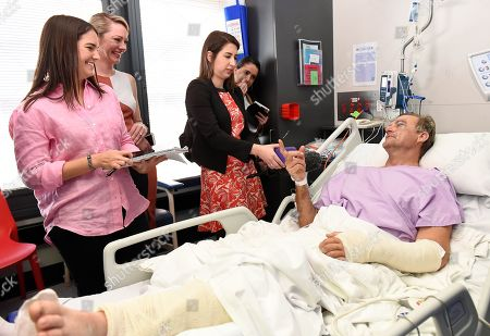 Bushwalker Neil Parker (R) speaks to the media at Princess Alexandra Hospital in Brisbane, Australia, 18 September 2019. Neil Parker, 54, fractured his leg and wrist in the six-metre fall on 15 September while walking by himself in Cabbage Tree Creek on Mount Nebo, northwest of Brisbane.