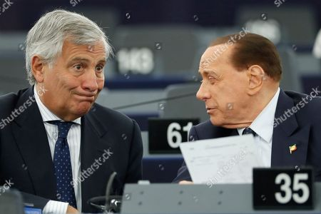 """Italy's Antonio Tajani, left, talks with Silvio Berlusconi during a session at the European Parliament in Strasbourg, eastern France. The risk of Britain leaving the European Union without a divorce deal remains """"very real,"""" European Commission chief Jean-Claude Juncker declared Wednesday as EU lawmakers debated the ramifications of a no-deal Brexit"""