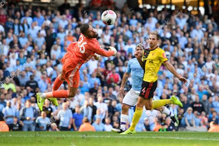 Goal keeper Ben Foster of Watford dives for the shot of Sergio Aguero of Manchester City.