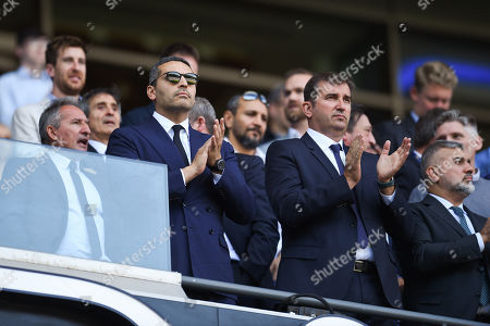 Manchester City Chairman Khaldoon Al Mubarak apluads the team.