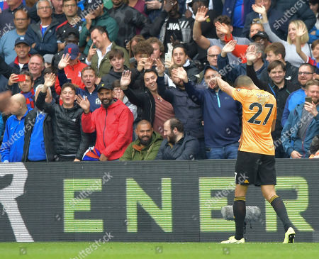 Romain Saiss of Wolverhampton Wanderers walks off after being shown a red card