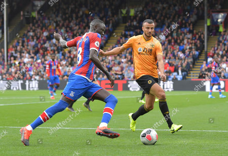 Cheikhou Kouyate of Crystal Palace under pressure from Romain Saiss of Wolverhampton Wanderers
