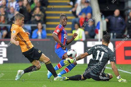 Wilfried Zaha of Crystal Palace with a shot on goal saved by Rui Patricio goalkeeper of Wolverhampton Wanderers