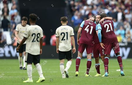 Pablo Zabaleta of West Ham United  celebrates with team-mates  Declan Rice  and  Angelo Ogbonna after the match