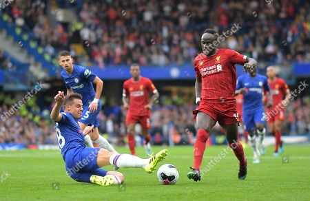 Sadio Mane of Liverpool is tackled by Cesar Azpilicueta of Chelsea