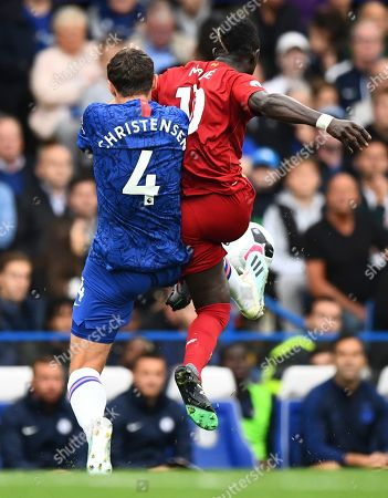 Andreas Christensen of Chelsea clatters into Sadio Mane of Liverpool