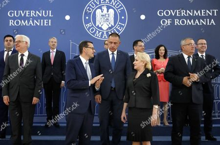 Romanian Prime Minister Viorica Dancila (center-R) and Polish Prime Minister Mateusz Morawiecki (center-L), backed by their cabinets members and the Romanian vice premier Mihai Fifor (C), chat before a family photo, at the end of the two governments working meeting held at Victoria Palace in Bucharest, Romania, 18 September 2019. Morawiecki arrives in Bucharest, together with his cabinet members for the Romania- Poland Intergovernmental Meeting.