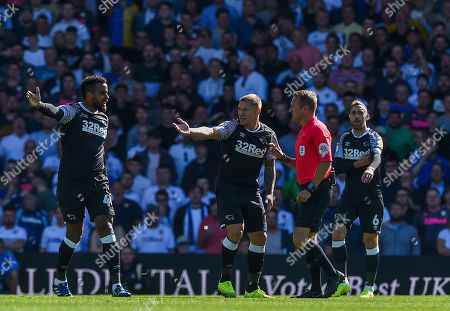 Tom Huddlestone and Martyn Waghorn of Derby County confront referee Oliver Langford