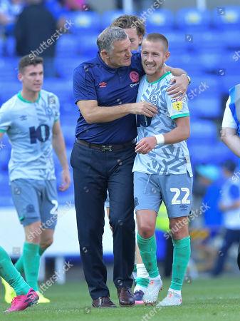 Manager Tony Mowbray of Blackburn Rovers congratulates Lewis Holtby of Blackburn Rovers at the final whistle