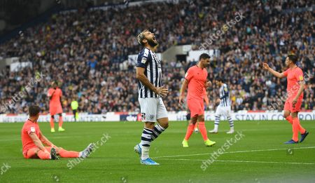 Charlie Austin of West Bromwich Albion reacts after going close