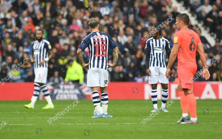 Charlie Austin of West Bromwich Albion and his team-mates are dejected after conceding a second goal