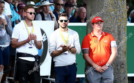 England Cricketers Stuart Board and James Anderson watch on.