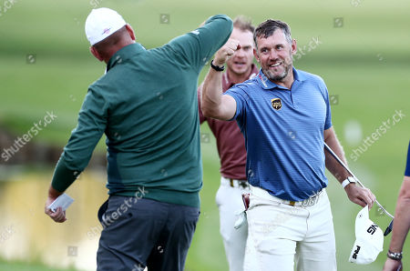 Lee Westwood of England and Thomas Bjorn of Denmark fist bump.