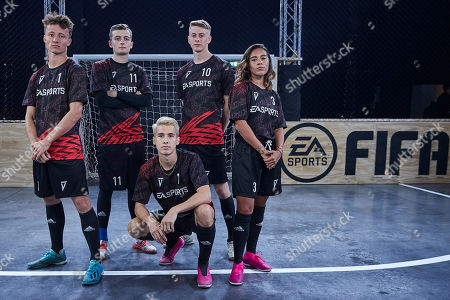 Chelcee Grimes and members of Team London pose as players from across 15 cities compete in a 5-a-side football tournament at the EA SPORTS FIFA 20 World Premiere. FIFA 20 is available from September 27th