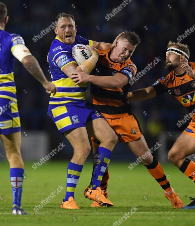 Ben Westwood of Warrington Wolves is tackled by Adam Milner of Castleford Tigers