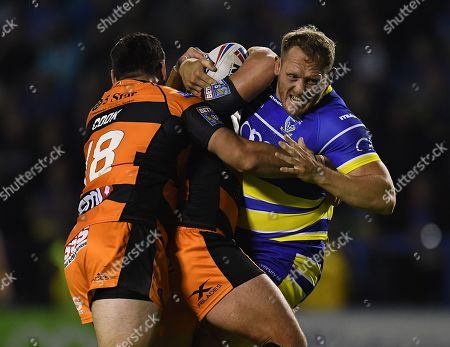Stock Picture of Ben Westwood of Warrington Wolves is tackled by Matt Cook and Paul McShane of Castleford Tigers